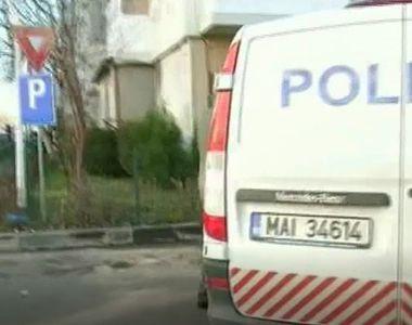 Un politist din Olt a fost impuscat in cap de catre iubita sa cu propriul pistol