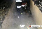 Incendiu intr-un bloc din Capitala. O femeie a ramas blocata pe balcon