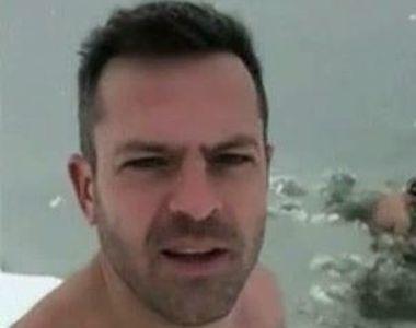 Doi tineri au sfidat frigul si au facut baie in lacul Morii din Bucuresti! Trecatorii...