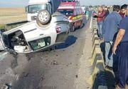 Accident TERIBIL! Un barbat a fost strivit de o masina care s-a rasturnat peste el , iar o femeie insarcinata este una dintre victime
