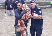 Imaginile durerii! Zeci de oameni au fost evacuati din casele lor, din localitatea Babeni, judetul Valcea. Jandarmii si pompierii au scos oamenii din ape