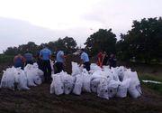 Noapte alba pentru cei de la ISU! Salvatorii au intervenit in 21 de localitati afectate de inundatii!