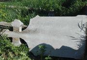 Un craiovean a murit in cimitir, strivit sub o cruce de beton!