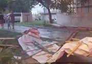 O vijelie puternica a rupt copaci si a smuls un acoperis la Timisoara, iar potopul care a cazut a inundat strazi, case, curti, subsoluri si garaje. Toti pompierii de la ISU Timis au intervenit