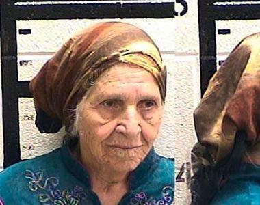 Batrana in varsta de 87 de ani , arestata de politisti pentru ca taia papadiile de pe...