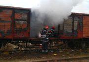 Un vagon de marfă încărcat cu cărbuni a luat foc în Vrancea! Pompierii s-au luptat cu flăcările preţ de câteva ore