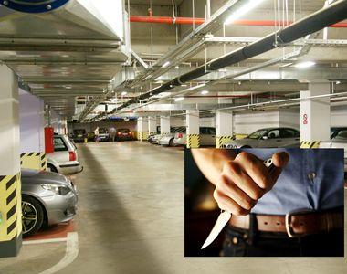 Incident şocant în parcarea unui mall din Ploieşti. Doi tineri, înjunghiaţi în spate....