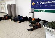 Peste 180 de români, blocaţi de sâmbătă pe aeroportul Luton din Londra! Au dormit pe jos şi nici acum nu ştiu când vor ajunge la Cluj!