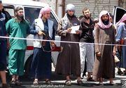Un barbat a fost mutilat pe viata de catre ISIS pentru ca a furat. Sute de oameni au asistat la scena grotesca