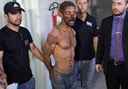 In momentul in care a fost prins, cativa localnici l-au lovit in fata. Din acest motiv, barbatul are fata plina de rani. Sursa foto: Daily Mail