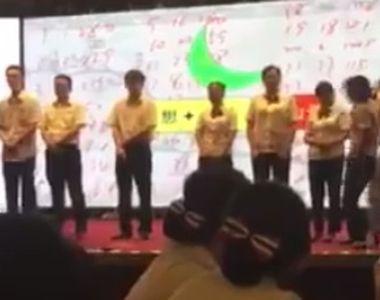Imagini socante. Presedintele unei banci din China si-a batut cativa angajati la fund...