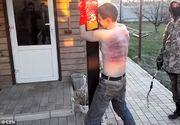 """Nu a murit inca"" striga un soldat ucrainean in timp ce ingroapa de viu un separatist rus"