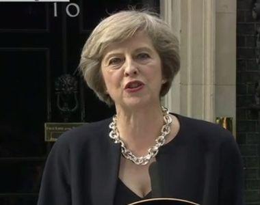 Theresa May a primit oficial mandatul de premier al Marii Britanii