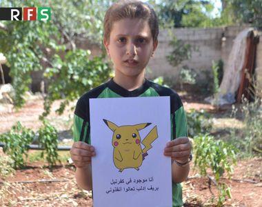 Imagini dramatice. Copiii din Siria tin in mana poze cu pokemoni in speranta ca lumea...