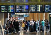 Zeci de mii de pasageri ai companiei Delta, blocati in aeroporturi din intreaga lume