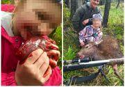 Un vanator din Noua Zeelanda a postat o fotografie cu fiica lui, alaturi de prima sa captura. Fetita de 8 anisori musca din inima cruda a animalului