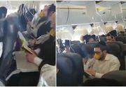Panica la bordul unui avion. Pasagerii, toti cu mastile de oxigen la gura, au inceput sa se roage in cor