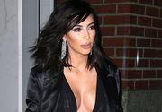 Kim Kardashian, amenintata cu arma de barbati mascati, la Paris