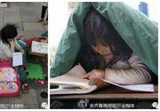 Imagini emotionante: O fetita isi face temele pe strada in frig, in timp ce cerseste alaturi de tatal sau. Familia este foarte saraca, iar mama are probleme psihice