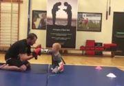 Un baietel de opt ani fara maini si picioare face arte martiale! Baiatul e un adevarat luptator