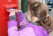 Un copil din Zalau lasa oamenilor mesaje de Paste in cutiile postale