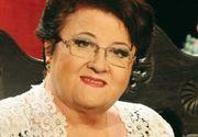 Marioara Murarescu are mormantul impodobit cu crengute de brad si beteala. Fiul ei l-a aranjat asa