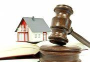 27 de romani au castigat procesele cu bancile privind legea darii in plata