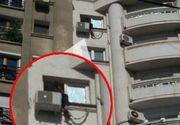 Un bucurestean ameninta ca se sinucide! E cocotat la etajul al saptelea, pe aparatul de aer conditionat, si zice ce se arunca! Imagini socante