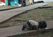 Copiii saraci din Argentina, obligati sa bea apa din balti, de pe strada. Imaginile sunt cutremuratoare