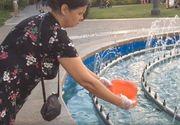 O femeie a spalat olita copilului in fantana unui parc din Iasi. Reactia ei a fost incredibila atunci cand oamenii i-au spus ca nu e normal ce face