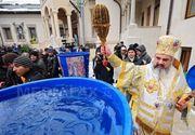 Slujba de Bobotează, oficiată de Patriarhul Daniel. Sute de oameni stau la coadă pentru agheasmă