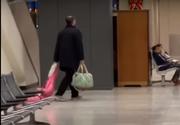 Un tată îşi târăște fiica de glugă printr-un aeroport. Momente halucinante