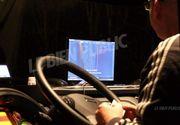 Români, șoferi de TIR, prinși în timp ce conduceau și se uitau la filme pentru adulți