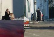 Scene halucinante într-o benzinărie. Un preot fals, surprins în timp ce spovedea o enoriașă pe trotuar