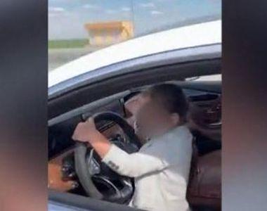 VIDEO | Copil de cinci ani, filmat in timp ce conduce un bolid de lux
