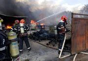 VIDEO. Incendiu violent la un depozit din Ramnicu Valcea. O femeie a suferit arsuri grave