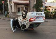FOTO | Un polițist beat s-a răsturnat cu mașina de serviciu