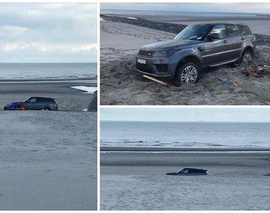 Un român a îngropat un SUV de lux nou-nouţ pe plajă, în Belgia. Scena pare ireală!
