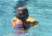 O fetiță de 9 ani a murit în piscina din curtea casei după ce a atins un obiect de pe fundul piscinei