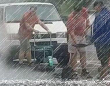 VIDEO   Ca la noi, la nimeni! Mai mulți muncitori, surprinși în timp ce asfaltau...