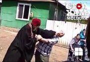 Imagini șocante surprinse la o înmormântare, în Moldova. Un preot s-a luat la bătaie cu rudele mortului - VIDEO