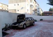 Un preot din Dâmboviţa a dat foc maşinii soţiei când a aflat că femeia a plecat la mare
