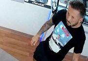 Acest bărbat de 33 de ani a snopit în bătaie o femeie într-un mall. Poliția cere ajutorul pentru prinderea agresorului