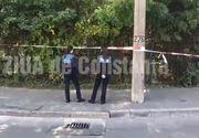 Descoperire șocantă în Constanța. Doi tineri au găsit un cadavru în stare avansată de putrefacție în spatele unui gard