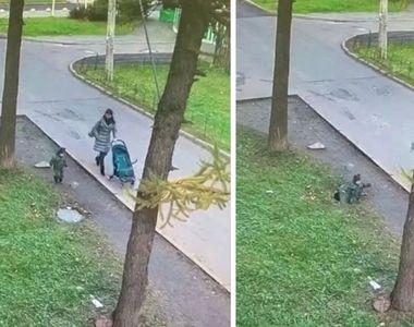 Clipe de coșmar pentru o mamă. Copilul cade în canal, pe stradă, sub ochii ei