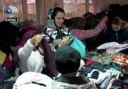 VIDEO | Un zâmbet pentru copiii sărmani. Bucureștenii pot dona haine și jucării în containere special amenajate