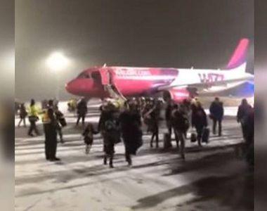 Pasagerii unei curse WizzAir, evacuați pe tobogane în urma unei alerte de incendiu....