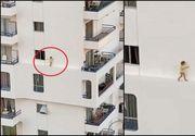 Imagini terifiante cu o fetiță care merge pe bordura îngustă a fațadei unei clădiri la etajul 4