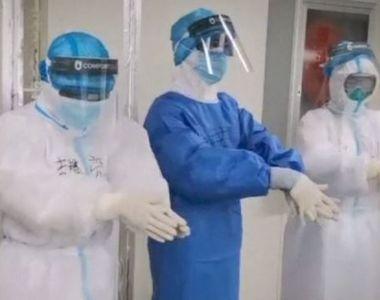 VIDEO | Imaginile zilei vin din China lovită de coronavirus: Medicii poartă câte două...