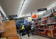 """Imagini halucinante cu un cadavru la magazin, în timp ce oamenii fac cumpărături nepăsători: """"La noi, morții cu morții, viii cu viii, cum se zice, nu?"""""""
